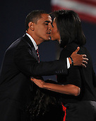 Chicago, IL - November 4, 2008 -- United States President-elect Barak Obama kisses his wife, Michelle after speaking in Lower Hutchinson Field, Grant Park, Chicago, Illinois after his election as President of the United States on Tuesday, November 4, 2008..Credit: Ron Sachs / CNP.(Restriction: No New York Metro or other Newspapers within a 75 mile radius of New York City)
