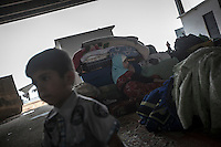 Syrian refugees rest as they arrive to the Azaz border check point used as temporary shelter by those who flee from army shelling in the northern villages of Aleppo province. Due the flowing of thousands of Syrian refugees who have crossed into Turkey fleeing from aircraft bombing, the turkish government have closed the border leaving dozens of hundreds of families stuck along the border areas, mostly of them children and women.