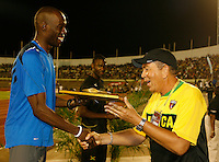 Khadevis Robinson accepting his award after winning the 800m in a time of 1:45.67sec. at the Jamaica International Invitational Meet held at the National Stadium on Saturday, May 2nd. 2009. Photo by Errol Anderson,The Sporting Image.net