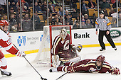 Scott Savage (BC - 28) helps Thatcher Demko (BC - 30) defend against Robbie Baillargeon (BU - 19). - The Boston College Eagles defeated the Boston University Terriers 3-1 (EN) in their opening round game of the 2014 Beanpot on Monday, February 3, 2014, at TD Garden in Boston, Massachusetts.