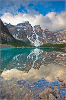 On a calm morning at Moraine Lake in Banff National Park, the rugged mountains of the Canadian Rockies are reflected in the still waters. I visited this location several times over the course of the week, and this was the only morning the weather was conducive to capturing images of this beautiful location.