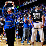 "University of Kentucky President Lee Todd holds up $100 dollars donated to the President's Scholarship Initiative after Kenny ""Sky"" Walker fit into his old college basketball shorts during ESPN College Game Day at Rupp Arena on Saturday. Photo by Zach Brake 