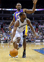 Gilbert Arenas of the Wizards has a tough time scoring while defended by Lakers' Ron Artest. Los Angeles defeated Washington 103-89 at the Verizon Center in Washington, DC on Tuesday, December 14, 2010. Alan P. Santos/DC Sports Box