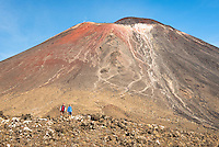 Hikers under Mount Ngaruhoe, Tongariro Alpine Crossing Track, Tongariro National Park, Central Plateau, North Island, UNESCO World Heritage Area, New Zealand, NZ
