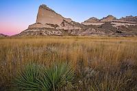 Scotts Bluff National Monument, Nebraska: Scotts Bluff rises above prairie grasses at dawn.