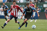 Chris Wondolowski (right) controls the ball ahead of Ben Zemanski (21) Chivas USA defeated the San Jose Earthquakes 2-1 at Buck Shaw Stadium in Santa Clara, California on April 23rd, 2011.