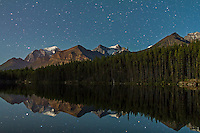 The star over Herbert Lake, Banff, Alberta, near Lake Louise. Mount Temple is glacier-clad peak at left. A single exposure of 45 seconds at f/2 with 24mm lens and Canon 7D at ISO 640. Taken at the end of a time-lapse sequence just as light from the rising waning quarter Moon lit up the lake. Original with RAW files for time-lapse sequence.