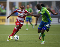 Jackson, left, of FC Dallas dribbles the ball  upl the field against the Djimi Traore  of Seattle Sounders FC during play at CenturyLink Field in Seattle Saturday August, 3, 2013. The Sounders defeated Dallas 3-0.