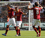 Calcio, Serie A: Roma-Bologna. Roma, stadio Olimpico, 16 settembre 2012..AS Roma midfielder Alessandro Florenzi, center, celebrates with teammates Nicolas Burdisso, left, and Erik Lamela, after scoring during the Italian Serie A football match between AS Roma and Bologna, at Rome, Olympic stadium, 16 September 2012. .UPDATE IMAGES PRESS/Isabella Bonotto