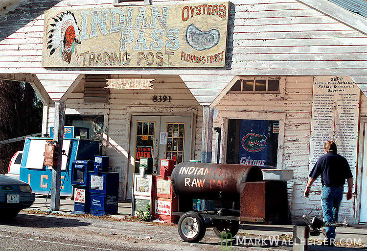 A customer heads into the Indian Pass Trading Post, a popular rural spot for raw oysters and cold beer at the intersection of Gulf county at Indian Pass in the north Florida panhandle near Apalachicola.