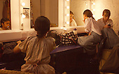 """Getting ready in the dressing room.  Drama group for 8-13s rehearsing a production of """"Alice"""" in the Mill Studio at the Yvonne Arnaud Theatre, Guildford, Surrey."""