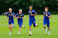 Motion blur of Bobby Zamora, Andy Johnson , Shaun Derry and Yun Suk-Young of QPR in training
