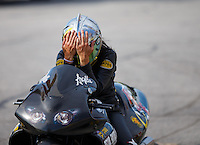Sep 25, 2016; Madison, IL, USA; NHRA pro stock motorcycle rider Angelle Sampey reacts after losing in the final round of the Midwest Nationals at Gateway Motorsports Park. Mandatory Credit: Mark J. Rebilas-USA TODAY Sports