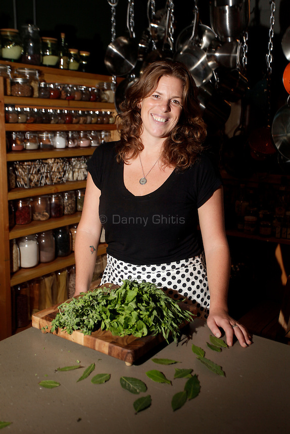 "Brooklyn, New York: Nissa Pierson, owner of Ger-Nis International, poses for a portrait in her company's kitchen in Brooklyn on October 1, 2010. The center hosts cooking classes 3 or 4 days per week that ""educate people about where their food comes from, she said. Participants also ""learn how to cook with ease.""  Ger-Nis also imports organic and fair trade fruits, vegetables and herbs from around the world. (Photo by Danny Ghitis/amNY)"