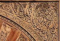 Architectural detail of the Puerta de San Ildefonso, built under Al-Hakam II in the 10th century, one of the West facade entrances to the Cathedral-Great Mosque of Cordoba, on the Calle Torrijos in Cordoba, Andalusia, Southern Spain. This detail shows the intricately carved  vegetal patterns on the frame around the arch. The first church built here by the Visigoths in the 7th century was split in half by the Moors, becoming half church, half mosque. In 784, the Great Mosque of Cordoba was begun in its place and developed over 200 years, but in 1236 it was converted into a catholic church, with a Renaissance cathedral nave built in the 16th century. The historic centre of Cordoba is listed as a UNESCO World Heritage Site. Picture by Manuel Cohen