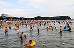 People play in the sea at the 11th Annual Mud Festival in Boryeong, South Korea, 2008.