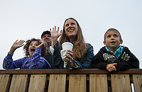 """The Bohannon Family, of Louisville, enjoys """"Dawn At The Downs"""" as contenders for the 138th Kentucky Derby work out at Churchill Downs in Louisville, Kentucky on May 1, 2012. Alaina and her mother Gaia wave to a passing horses as Vincent and his father Randall look on."""