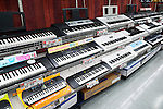 Synthesizers, electronic keyboards on music instrument store display in Tokyo, Japan