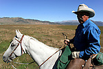 Wrangler on a Dude Ranch - A cowboy is an animal herder who tends cattle on ranches in America traditionally on horseback and often performs other ranch related tasks. The American cowboy of the late 19th century arose from the vaquero traditions of northern Mexico and became a figure of special significance and legend while a wrangler, specifically tends the horses used to work cattle. In addition to ranch work, some cowboys participate in rodeos.