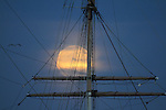 The October full moon rose over the Balclutha which is a three-masted, steel-hulled, square-rigged ship built to carry a variety of cargo all over the world. Launched in 1886 by the Charles Connell and Company shipyard near Glasgow, Scotland, the ship carried goods around Cape Horn (tip of South America) 17 times. It took a crew of about 26 men to handle the ship at sea with her complex rigging and 25 sails.