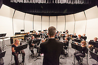 The Western Concert Band practices for a concert in Taylor Hall Auditorium.
