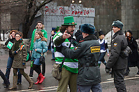 Moscow, Russia, 21/03/2010..Police prevent revellers from crossing a police line as several thousand people attend the 19th annual Moscow St Patrick's Day parade.