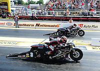 May 4, 2012; Commerce, GA, USA: NHRA pro stock motorcycle rider Andrew Hines (near Lane) races alongside Eddie Krawiec during qualifying for the Southern Nationals at Atlanta Dragway. Mandatory Credit: Mark J. Rebilas-