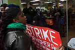 A customer of a McDonald's restaurant reacts while Fast food workers take part in a  protest for Increased their wages in New York, April 04, 2013. Photo by Eduardo Munoz Alvarez / VIEWpress.
