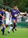 11 September 2009: University of Portland Pilots' midfielder Jarad vanSchaik (21), a Junior from Tualatin, OR, battles University of Vermont Catamount forward/midfielder T.J. Gore, a Senior from Macomb, MI, in the first round of the 2009 Morgan Stanley Smith Barney Soccer Classic held at Centennial Field in Burlington, Vermont. The Catamounts and Pilots battled to a 1-1 double-overtime tie. Mandatory Photo Credit: Ed Wolfstein Photo