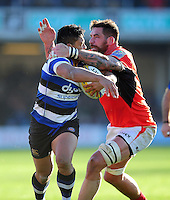 Ben Tapuai of Bath Rugby is tackled by Jim Hamilton of Saracens. Aviva Premiership match, between Bath Rugby and Saracens on December 3, 2016 at the Recreation Ground in Bath, England. Photo by: Patrick Khachfe / Onside Images