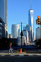 The New York's World Trade Center is seen at the background while a man crosses a street during a sunny day in the Neighborhood of Exchange Place in New Jersey, 12/15/2015 Photo by VIEWpress