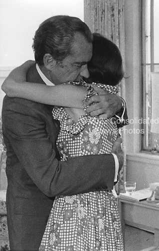 Washington, DC -- White House Photo from 7 August, 1974 showing United States President Richard M. Nixon hugging his daughter, Julie (Nixon) Eisenhower, prior to announcing his resignation from the U.S. Presidency..Credit: The White House / CNP