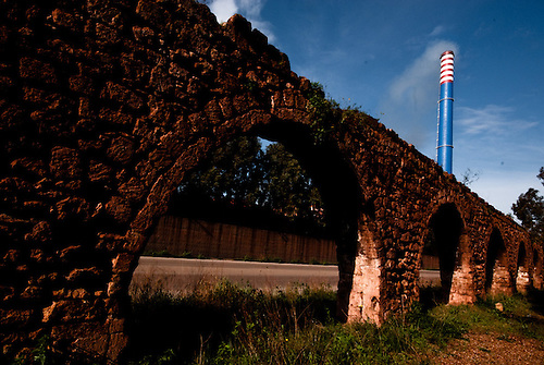 Taranto Italy 2010<br /> A roman aqueduct near ILVA steelworks, colored in red because of the iron dust accumulated.