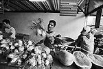 A vendor weighs produce at a black market in Havana, Cuba.