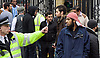 Far right activists protesting outside Regent's Park Mosque in Central London, Great Britain <br /> 3rd April 2015 <br /> <br /> <br /> <br /> Police and Muslims who have been praying at the Mosque. <br /> <br /> Photograph by Elliott Franks <br /> Image licensed to Elliott Franks Photography Services