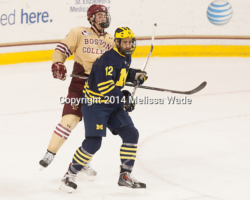 Ian McCoshen (BC - 3), Boo Nieves (Michigan - 12) - The Boston College Eagles defeated the visiting University of Michigan Wolverines 5-1 (EN) on Saturday, December 13, 2014, at Kelley Rink in Conte Forum in Chestnut Hill, Massachusetts.
