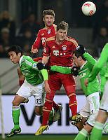 FUSSBALL   1. BUNDESLIGA   SAISON 2012/2013    22. SPIELTAG VfL Wolfsburg - FC Bayern Muenchen                       15.02.2013 Makoto Hasebe (li) und Marcel Schaefer (re, beide VfL Wolfsburg) gegen Thomas Mueller (hinten) und Bastian Schweinsteiger (Mitte, beide FC Bayern Muenchen)