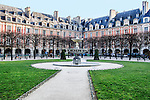 The Place des Vosges, located in the Marais, Paris. Originally known as the Place Royale, the square and the surrounding buildings were constructed in the early 17th century during the reigns of kings Henry IV and Louis XIII.