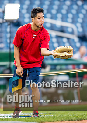 13 October 2016: Washington Nationals Athletic Training Assistant John Hsu helps out during batting practice prior to Game 5 of the NLDS against the Los Angeles Dodgers at Nationals Park in Washington, DC. The Dodgers edged out the Nationals 4-3, to take Game 5 of the Series, 3 games to 2, and move on to the National League Championship Series against the Chicago Cubs. Mandatory Credit: Ed Wolfstein Photo *** RAW (NEF) Image File Available ***