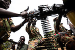 SPLA soldiers near Dalami show off weapons including a battle wagon they captured in a recent battle with SAF troops. The SPLA say they have surrounded Dalami and cut off all suplly lines except by helicopter. All civilians have fled the city.  near Dalami show off weapons including a battle wagon they captured in a recent battle with SAF troops. The SPLA say they have surrounded Dalami and cut off all suplly lines except by helicopter. All civilians have fled the city.