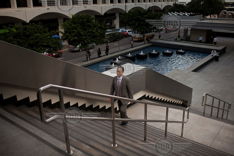 A man walks up steps in a commercial area of central Hong Kong.