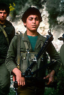 March 1982, Lebanon: in Rashidiya Camp, the most south Palestinian camp of the country. Here children in military clothes are being trained. They fire for real with various weapons and learn the basics of the guerilla.