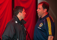 26 June 2010:  Los Angeles Galaxy head coach Bruce Arena speaks with Toronto FC head coach Preki during a game between the Los Angeles Galaxy and the Toronto FC at BMO Field in Toronto..Final score was 0-0...