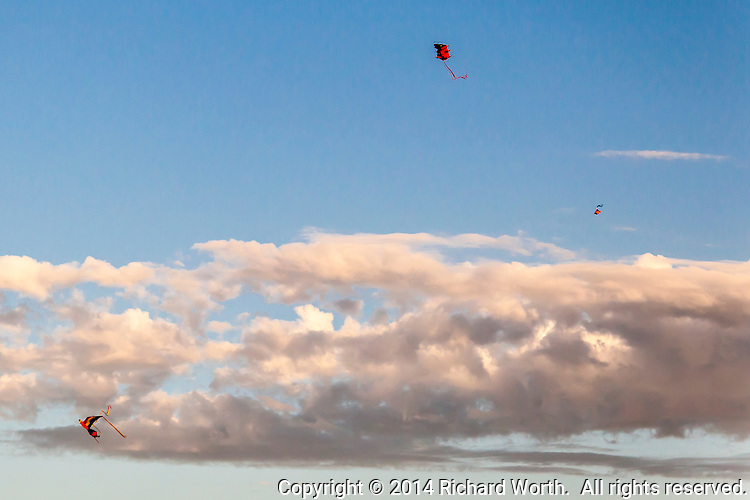 Three Kites - little dots of color, punctuation marks, on a lazy July sky fluffed with clouds.