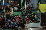Spectators gather to watch the India-Pakistan cricket match at the Suhrawardy Asian Boys' club in Park Circus in Kolkata, West Bengal, India.