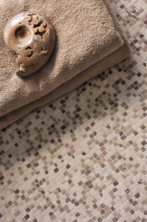1.0cm Hand-Chopped tumbled natural stone mosaic shown in Socorro Gray, Driftwood, and Chinese Purple.