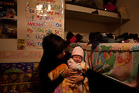 Liz, 18, tries to keep her baby girl warm at her parents house in Ciudad Juarez.