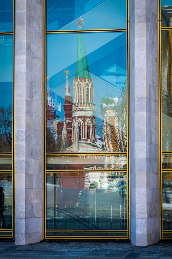 View of one of the traditional buildings being reflected in a modern structure of the Kremlin in Moscow