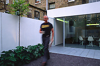 Tim walking out of house into the garden