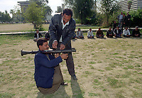 Men are given weapons training in a park. UN weapons inspectors in February 1998 look for WMDs (weapons of mass destruction), as the population in Iraq prepared for an armed conflict.   The UNSCOM weapons inspectors left Iraq later that year.<br /> <br /> <br /> <br /> &copy;Fredrik Naumann/Felix Features